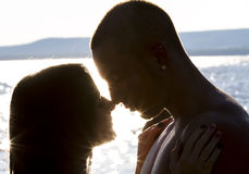 Love at the beach. Against day, young couple in love on the beach Royalty Free Stock Image