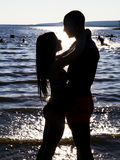 Love at the beach. Against day, young couple in love on the beach Stock Image