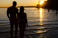 Love at the beach. Against day, young couple in love on the beach Royalty Free Stock Photography