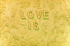 Love is. The beach message in the sand Stock Image