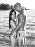 Love at the beach. Young couple in love at the beach, black and white with my photoshop treatment Stock Photo