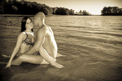 Love at the beach. Young couple in love at the beach, black and white with my photoshop treatment Stock Photography