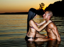 Love at the beach. Young couple who hugged for a swim Royalty Free Stock Image