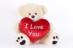 Love Bear. Soft plush toy with heart message Royalty Free Stock Images
