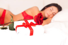 In love with a beautiful young girl lying in bed, Stock Photo