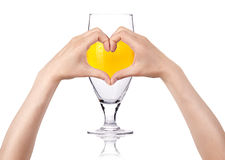 Love beer concept. Glass of beer with the heart  made of two women hands. love beer concept Stock Photography