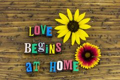 Love begins home family. Family relationship love begins at home friendship couple friends helping charity life giving duty people children letterpress stock images