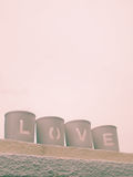 Love being spelled. The word love being spelled by the arrangement of objects Stock Photo