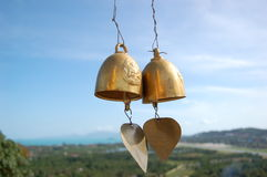 Love bells. Gold bells, calm and harmony Royalty Free Stock Photography