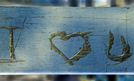 Love on the Bench. I love you scratched on the back of a park bench Stock Image