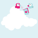 Love bird cartoon. Two love bird cartoons on a white cloud with a card on a string Royalty Free Stock Photography
