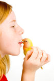 Love bird is cleaning tongue of little girl Stock Images