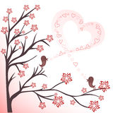 Love birds. Two love birds on flowering branches sing a song Stock Image