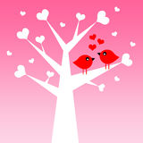 Love birds. Birds having a loving moment in a tree full of hearts (copyspace to the bottom of the image Stock Photography
