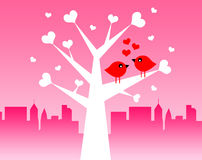 Love birds. In a tree of hearts Royalty Free Stock Image