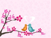Love birds sitting on tree branch. Pink seamless bloom pattern background with cute love birds sitting on tree branch Stock Photos
