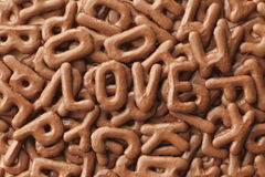 Love biscuits. LOVE written with Russian bread letter biscuits Royalty Free Stock Image