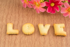 LOVE, Biscuits letters on wooden background Royalty Free Stock Image
