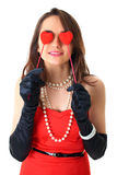 Love is blind, female holds two small hearts Royalty Free Stock Photo
