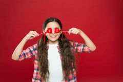 Love is blind. Funny girl covering eyes with hearts. Adorable girl with small red hearts on sticks. Small child with. Heart shaped decorations. Happy valentines royalty free stock image