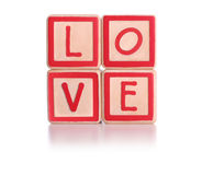 Love blocks. Isolated children's blocks spelling love with clipping path Stock Images
