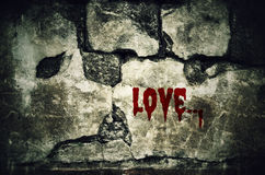 Love bloody on dirty brick wall with vintage and vignette tone - Royalty Free Stock Photo