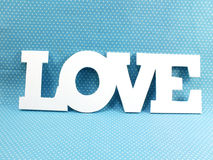 Love on blue polka dot background for valentines day Stock Images