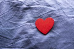 Love is Blue: Red Heart on Blue Pillow Stock Images