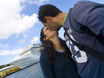 The Love Boat. Couple kissing with a large cruise at the background Stock Photo