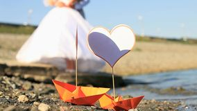 Love Boats. Origami boats with paper hearts on it stock video footage