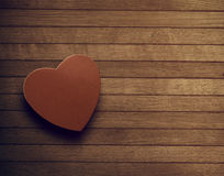 Love in a box. A love box on wood floor Stock Image