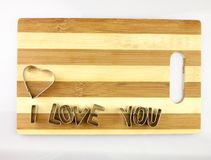 Love and bread cutting board Royalty Free Stock Photography