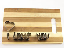 Love and bread cutting board. Royalty Free Stock Image