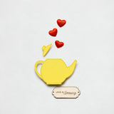 Love is brewing. Creative valentines concept photo of a teapot made of paper on white background Royalty Free Stock Images