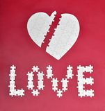 Love and broken heart puzzle Stock Image