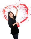 Love from a Brush. A beautiful young teen flinging paint behind her, creating a splattered red heart.  On a white background Royalty Free Stock Photos