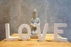 Love and Buddha statue Royalty Free Stock Photos