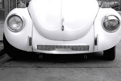 Love Bug. Cute white old car, black and white close-up of front lower half of automobile Royalty Free Stock Photos