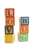 Love bug blocks. Wooden blocks stacked vertically, spelling Love Bug Royalty Free Stock Images