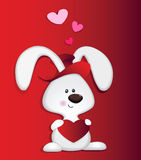 Love Bunny. A red hat bunny carrying heart shape in red background Royalty Free Stock Photos