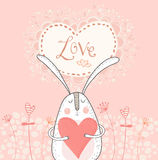 Love bunny with red heart.Love background. Rabbit in love. Royalty Free Stock Photography