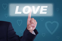 Love. Business man pressing shopping cart icon Royalty Free Stock Photo