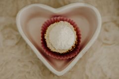 Love cake with a white snowball Royalty Free Stock Images