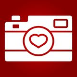 Love camera glyph icon, valentines day romantic. Love camera glyph icon, valentines day and romantic, photography sign vector graphics, a solid pattern on a red Stock Photography