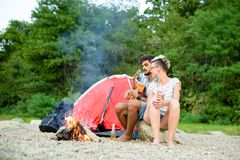 Love in camp. With guitar and camp fire Royalty Free Stock Photo