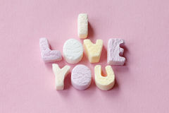 Love candies. Letter candies spelling out the words I love you Stock Photography