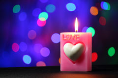 Love candle. On black table with blur light background, bokeh background Stock Photography
