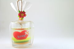 Love candle in the glass. Candle in the glass with red heart and love royalty free stock images