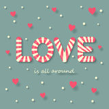 Love candy background. Love is all around concept with love candy on hearts and dots background Royalty Free Stock Photography