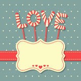 Love candy background. Love candy with frame and ribbon on dots background Royalty Free Stock Photo